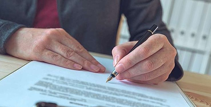 businesswoman signing contract and business partner